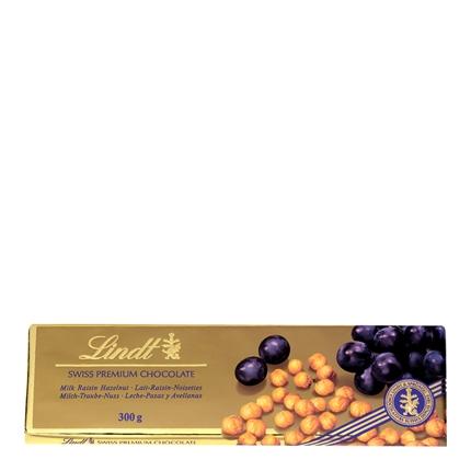 Chocolate suizo de leche con uvas pasas y avellanas entera
