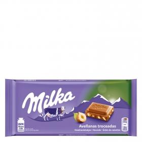 Chocolate con leche y avellanas troceadas Milka 125 g.